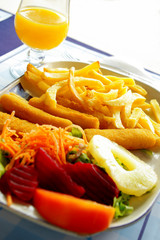 Crisp fried fish with french fries and assorted salad