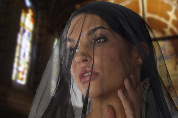 cute woman like widow with a black transparent veil on her face