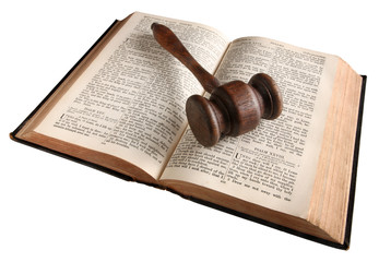 A wooden judge's gavel on an 1882 bible.