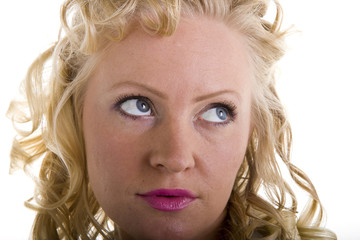 A woman with curly blonde hair closeup with eyes up