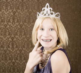 Portrait of pretty young girl with braces wearing a tiara