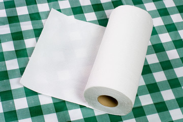 Roll of paper towel on tabletop.