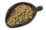 green lentils on a primitive, wooden scoop, isolated poster