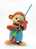 old plastic monkey toy  with broom poster