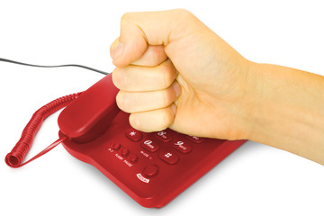 anger - business concept. fist with red telephone