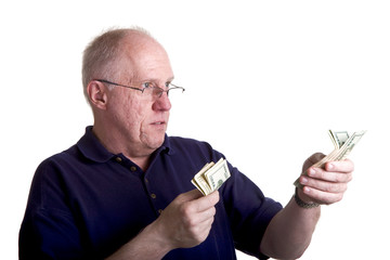 An older guy counting and handing out money