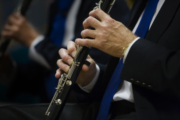 Flutists playing instruments