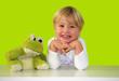 Leinwanddruck Bild - Blondes Mädchen mit Frosch
