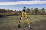 October surveying - instrument set in the field. poster
