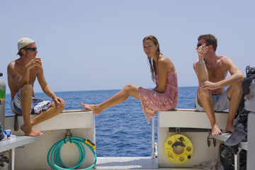 Divers relaxing on the Boat between Dives