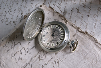 Old-time watch,,handwritten documents,history