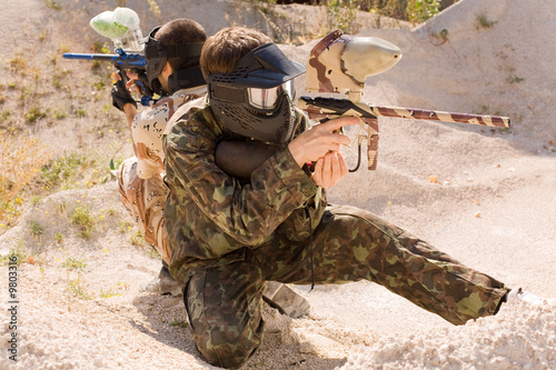 Paintball player hunting outdoors
