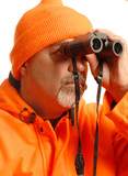 hunter  in orange blaze gear looking through binoculars poster