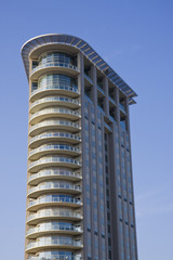 A high rise condo complex with curving balconies