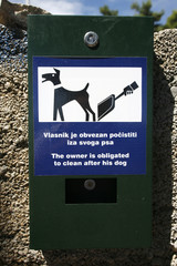 Plastic bag dispenser for dog poo in park