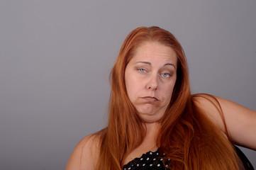 Disturbing Image of a very depressed woman on grey