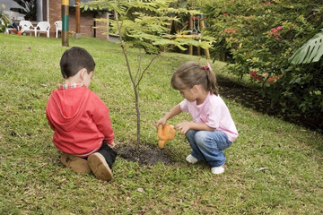 Little boy and girl having gardening time outside