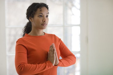 Young African American woman in yoga pose