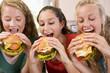 Teenage Girls Eating Burgers