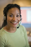 Smiling African American woman with earphones and microphone poster
