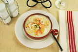 Delicious thick and creamy seafood chowder poster