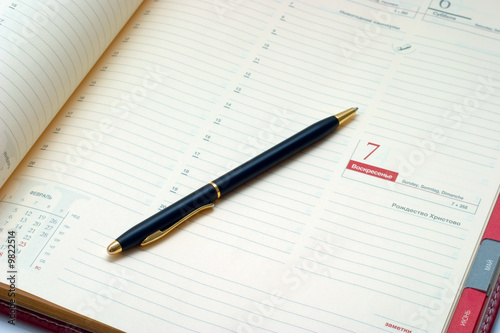 Business stuff - pen and agenda. Business concept...