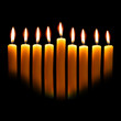 Hanukkah candles over black background with space for your text