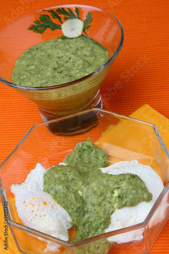 Salsa verde and cottage cheese sauce in glass bowl