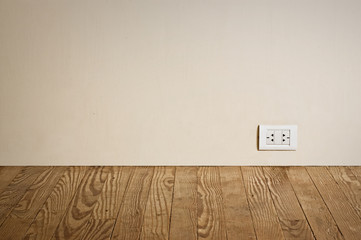 electric outlet in a wall in an old house interior