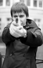 monochrome outdoor portrait of a man with gun