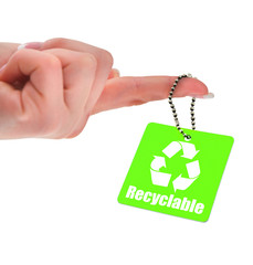 hand holding green tag with recyclable symbol