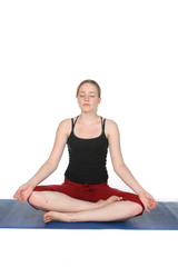 young woman demonstrating yoga lotus pose