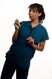 Attractive woman nurse  wearing scrubs poster