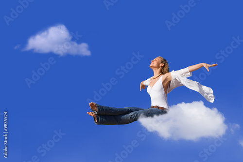flight concept woman traveling on cloud