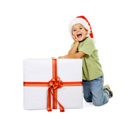 Excited boy with large present at christmas time - isolated