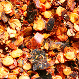 Crushed very hot red pepper close-up poster