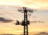 An overhead power line crossing a field poster