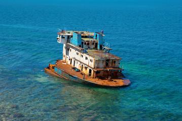 Wreck ship near the coast.