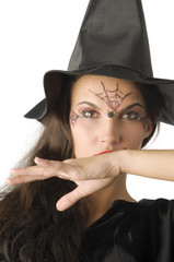 cute girl with witch hat and a spider web painted on face