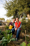 Happy Retired Couple in Their Vegetable Garden poster