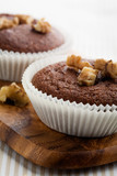 Chocolate muffins with crushed nuts poster