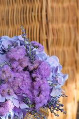 A colorful purple bridal bouquet of flowers