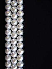 White Pearls on black background