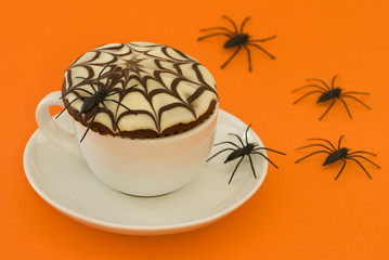Halloween spider web cupcake with creepy spiders scurrying away