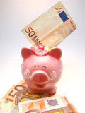 piggy bank and fifty euro on a white background, close up poster