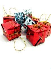 Gifts wrapped up in red shinny and silver paper