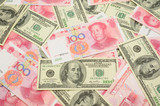 Background of US dollar bills and China yuan bills poster