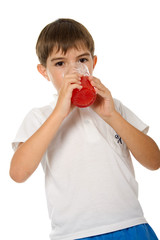 Boy with glass of juice. Isolated on white background
