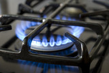 Blue flames of gas stove poster