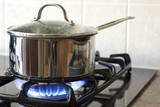 A stainless steel pot on a gas stove